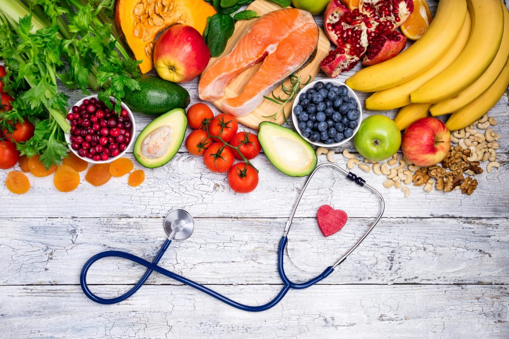 Healthy food for heart. Fresh fish, fruits, vegetables, berries and nuts. Healthy food, diet and healthy heart concept